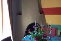 Dining Room & Kiva Fireplace.