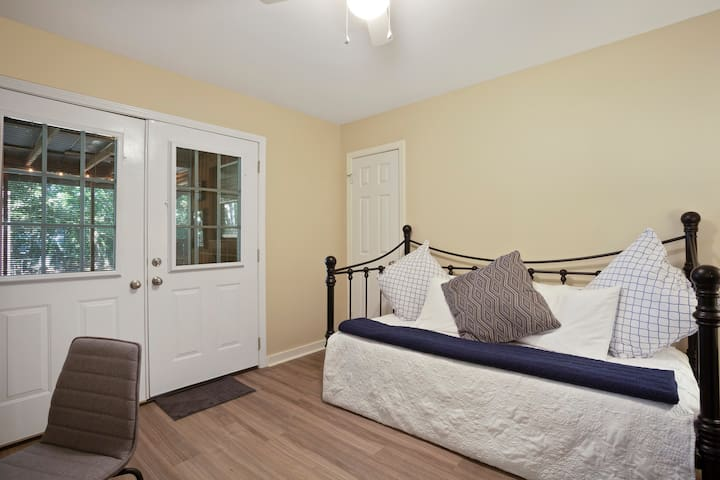 The third bedroom has a twin daybed with twin pull out trundle bed (2 twins), a desk, closet, dresser and doors to the back porch.