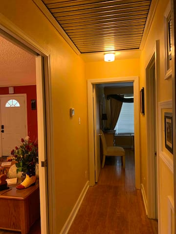 This is the hallway right off of the den which is between the two guest bedrooms with a bathroom.