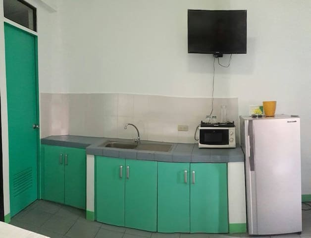 kitchen(microwave,t.v and refrigerator)