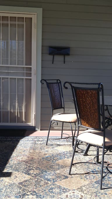 Deck entrance with 4 chairs and glass  table, 2 chairs to enjoy cool morn., eve., days.