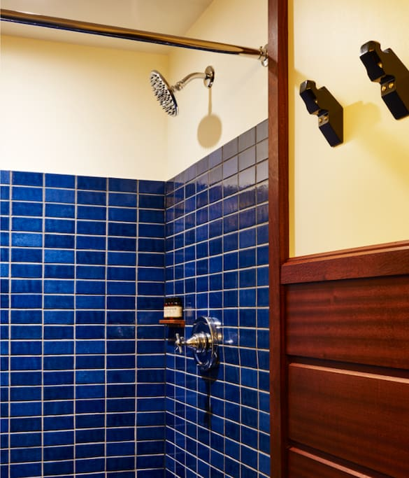 Our spacious bathrooms feature walk-in showers and Argan amenities