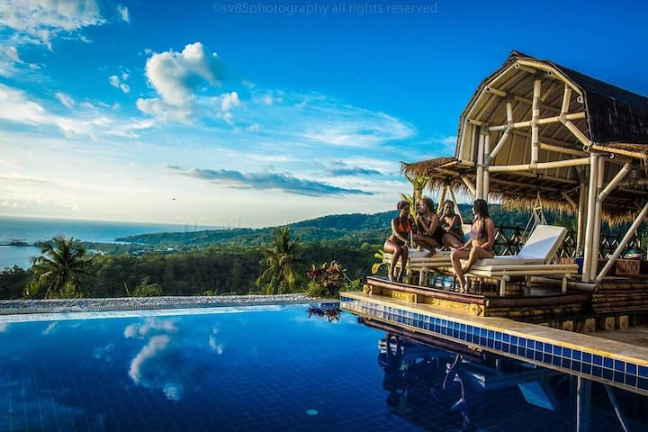 pool and restaurant with amazing ocean and sunset view