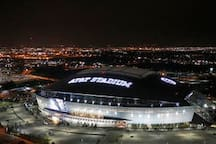 The famous AT&T Stadium, home of the Dallas Cowboys, with retractable roof and two 160' x 72' (yeah, that's FEET!!) HD monitors above the field!