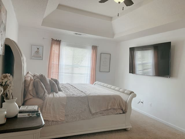 Beautiful large master bedroom with King Size memory foam plush bed. Oversized 75 inch screen tv with streaming apps such as Netflix and Starz. Ceiling fan if you like it cool.  Extra air mattress provided upon request for extra guests.