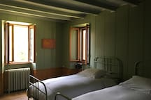 "bedroom ""Green Lichen"" with two single beds."