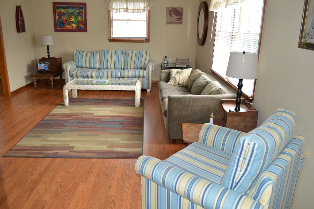 Large spacious living room has sleeper sofa.