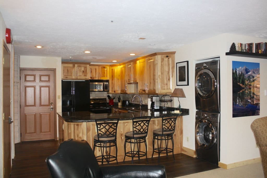 Newly enlarged and updated kitchen with full size washer/dryer.