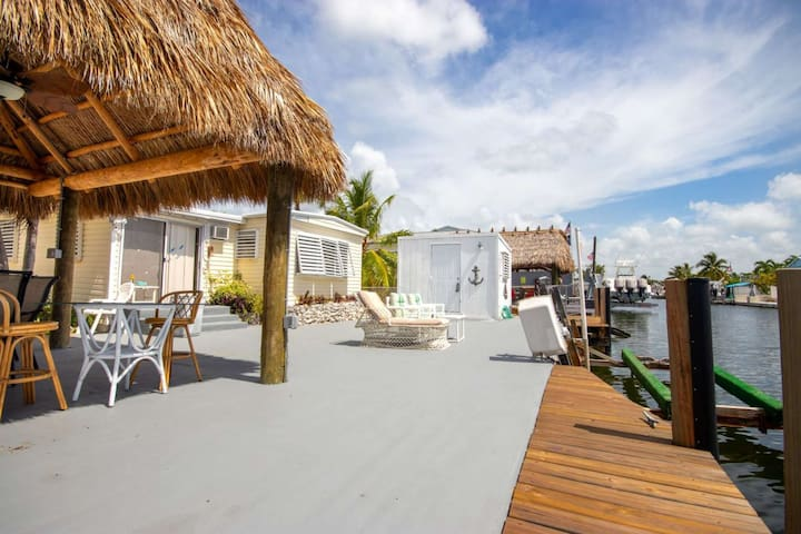 Relax under the tiki hut at this fabulous Key Largo home on canal with 60' dock on the bayside