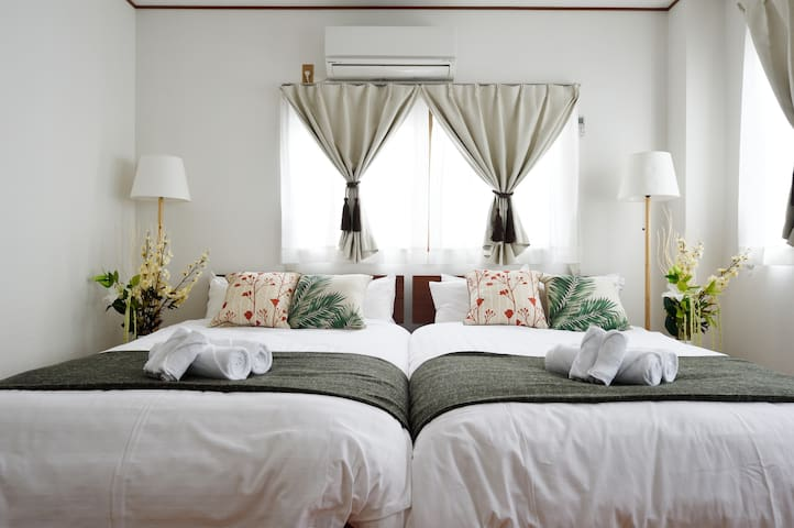 This is the bed room on the 3rd floor. This bed room has two double bed and one sofa-bed and mirror.  29