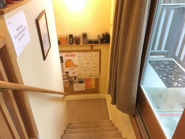 Stairs going down to the apartment (also open to our private space upstairs). The entry is the only shared space. We don't go downstairs when guests are here.