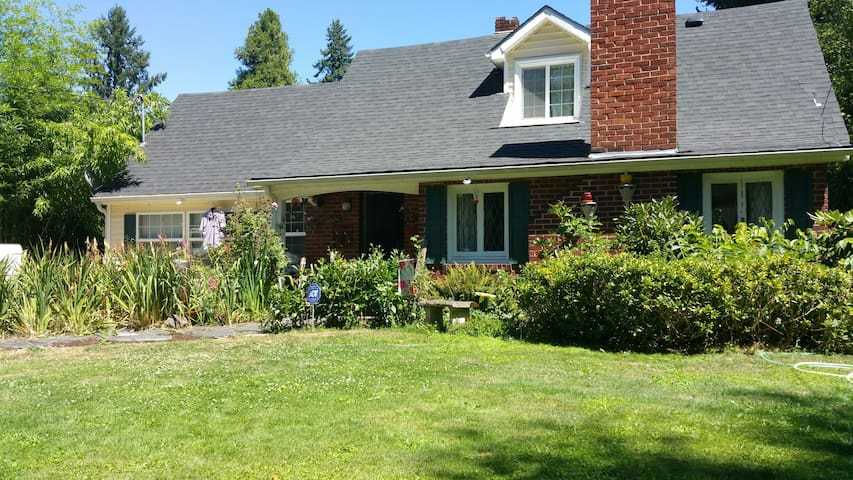 1938 cottage sits on 3/4 acre, provides a feeling of country cabin in the garden.