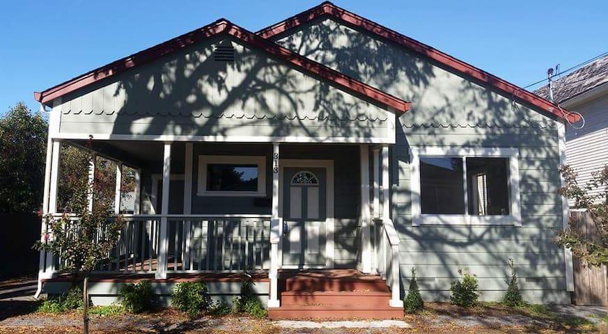 Historic home w/wraparound porch & great location