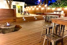 The epic deck really comes alive at night. Relax with friends and family around the fire pit.