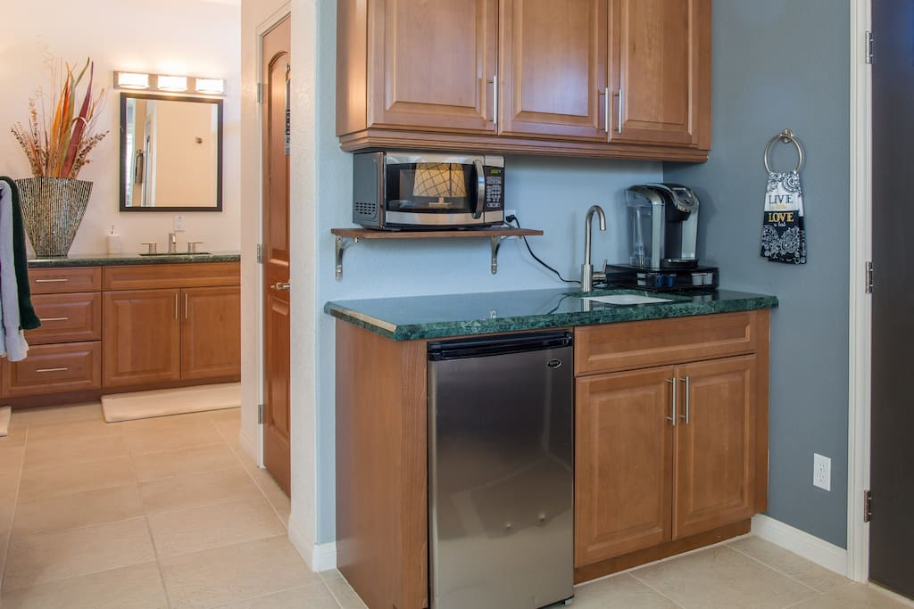 Make a hot cup of coffee or tea, microwave or toast something for breakfast on our beautiful Marble countertop.  Take advantage of the under counter refrigerator to store your leftovers, hold some sodas, beer, juice, etc.  2  ice trays in freezer for your beverages.