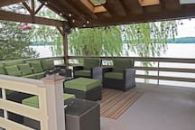 Covered deck with sweeping views of lake