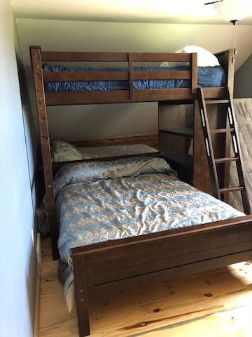 Upstairs bedroom with 2 fulls, 1 queen, and 1 twin bunk