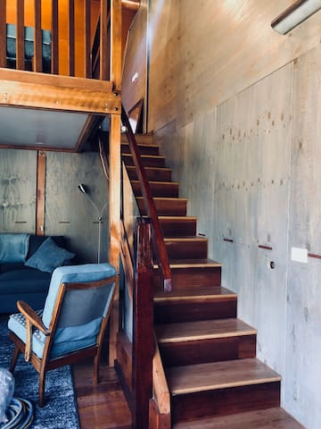 Beautiful staircase leading to sleeping loft made from recycled timbers, some from the MCG.