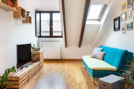 Head into Milan from a Characterful Attic Apartment