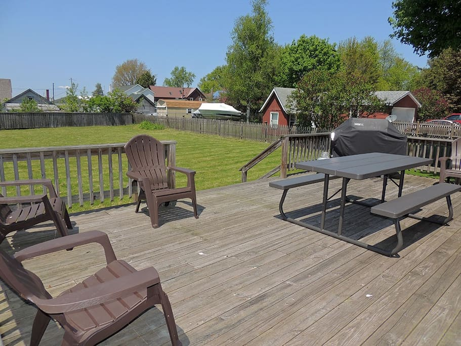 Large backyard deck with picnic table, gas grill and Adirondack chairs to sit back and enjoy your time away from home.   Off the deck is the oversized fenced in backyard -great for yard games and family time.