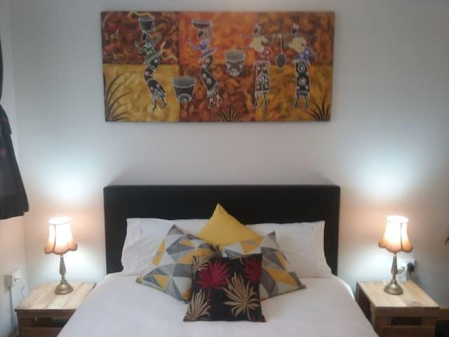 Your queen bed Mirrored wardrobe doors,ceiling fan and deskspace