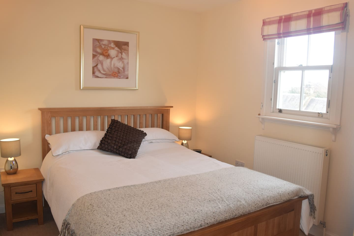 Your room with a kingsized bed and a comfortable mattress.