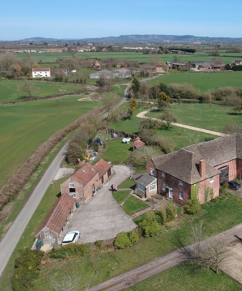 Aerial View(2) The Coach House is located on the left, opposite the main house, beautiful open countryside views.