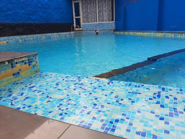 Stay in Wayanad with B. Fast and swimming Pool.