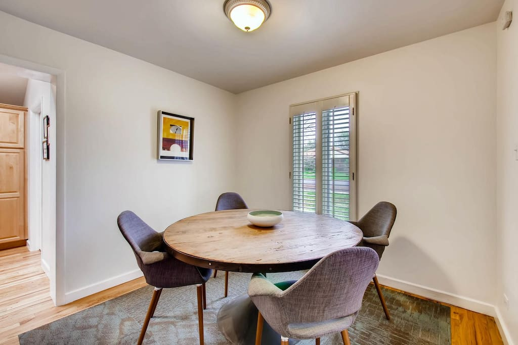 Dining room with seating for four, or comfortable workspace.