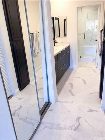 master bathroom, walk in closet and large oversized shower