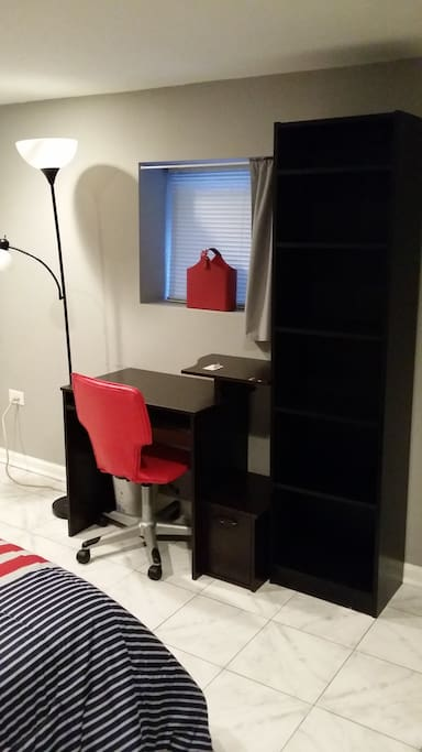 Well lit desk and good shelf space for all your clothing and other storage needs