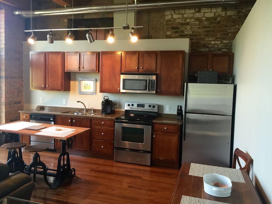 Fully equipped kitchen with architect table and copper topped stools for casual dining. Also drop leaf table that will seat 6 for dinner. Keurig coffee maker.