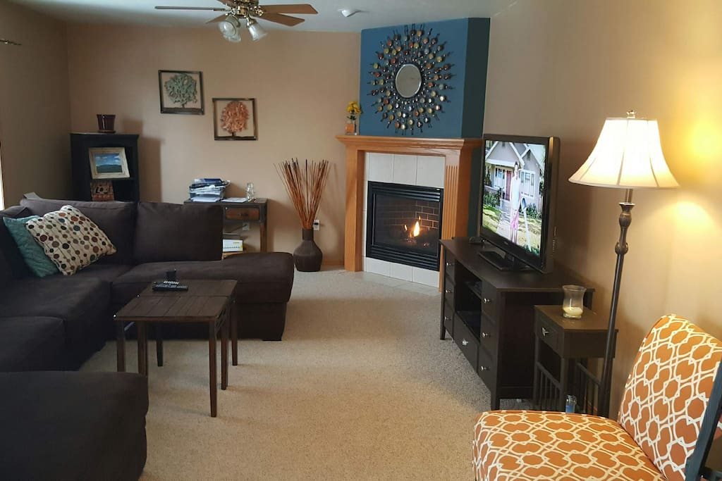 Living room with sectional couch and fireplace