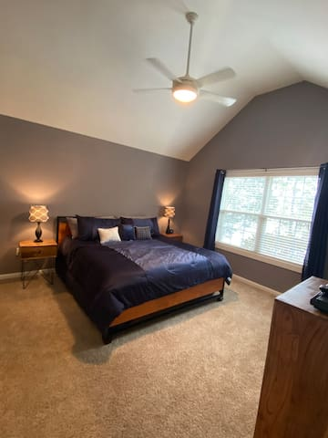 """King bed with memory foam mattress, en-suite full bathroom, 42"""" flatscreen with Blu-ray player, vaulted ceilings, and outside access."""