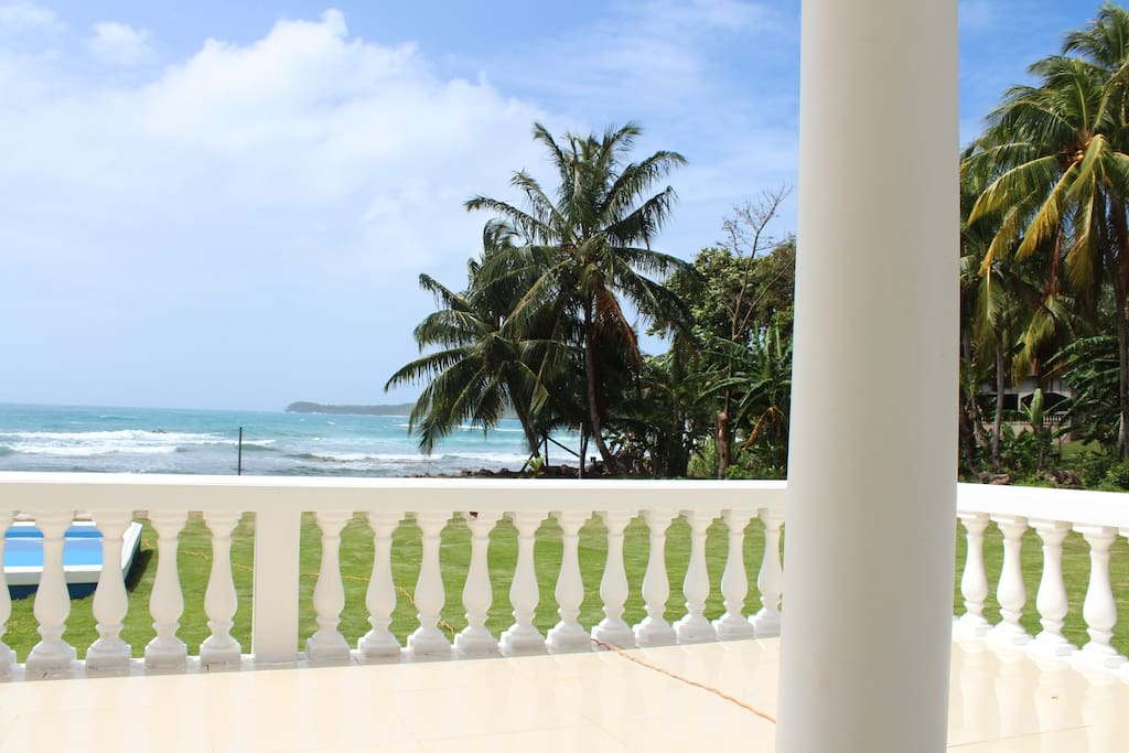 Ocean view from lounge terrace overlooking the pool.
