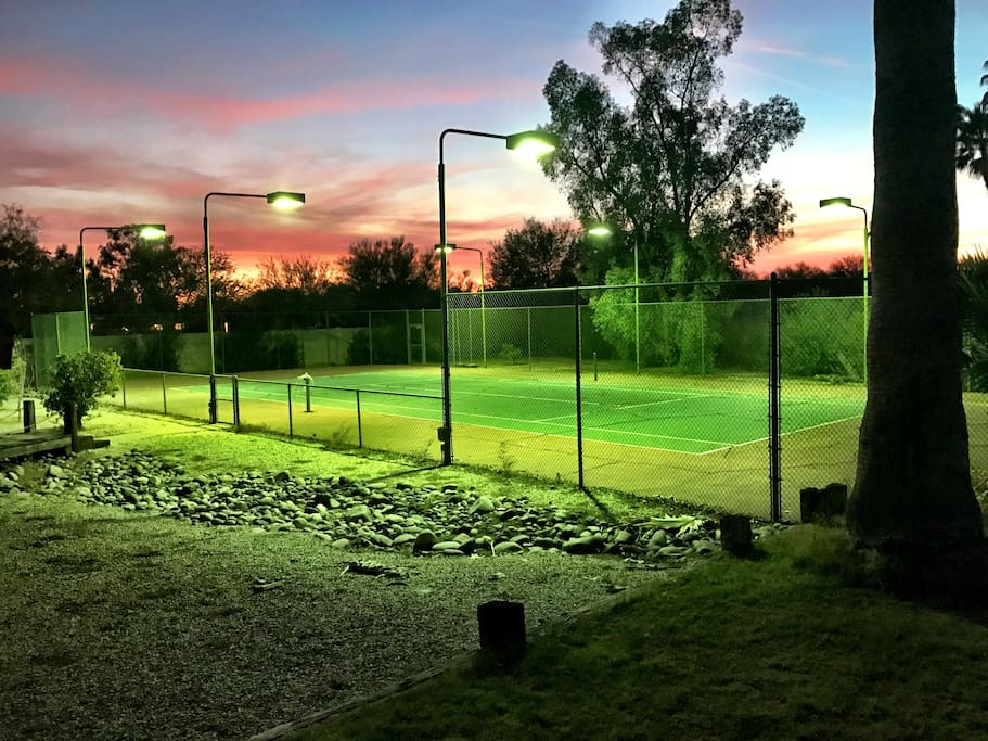**Damaged, private tennis court not useable for play but beautiful night lighting.