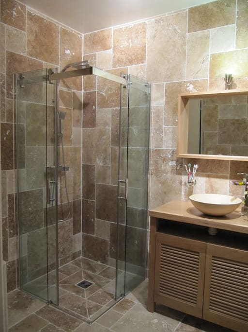 Walk in shower in private bathroom