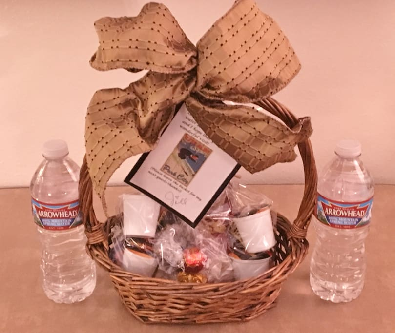 """Complimentary """"Welcome"""" basket filled with treats and water bottles to greet you as you arrive"""