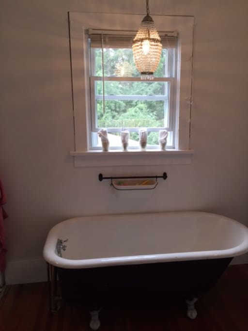 Original claw foot bathtub in addition to shower