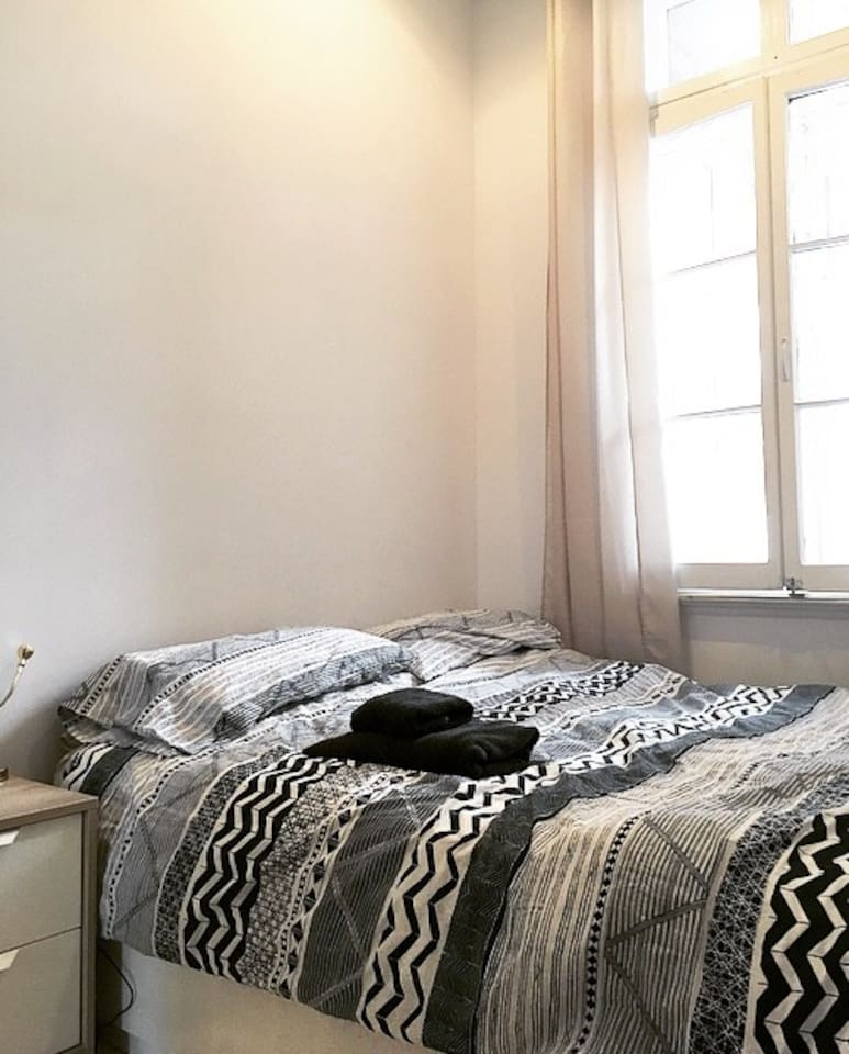 Room for two! Queen size bed with large window (east so sunrise)