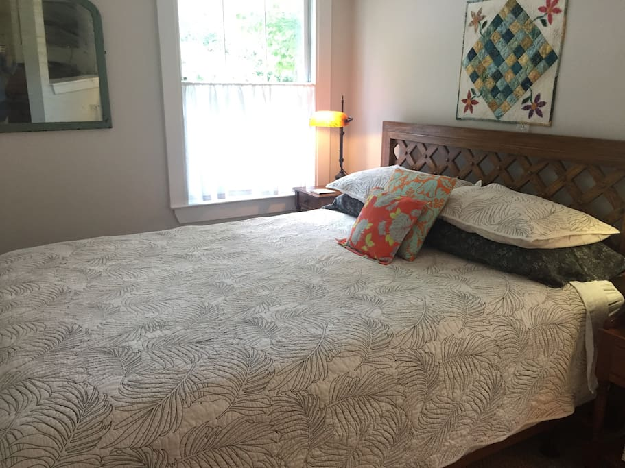 A second view of the bed with a different set of accent pillows. Your linens will be all 100% cotton and freshly laundered.