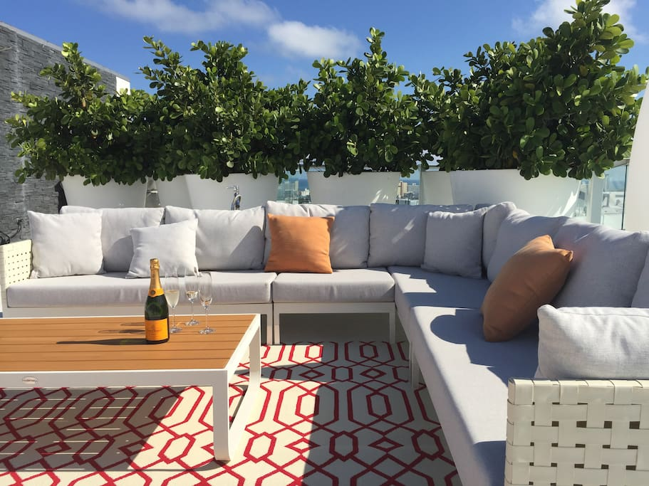 Private Rooftop Terrace with Separate Eating Area, Lounge area as well as sun chairs
