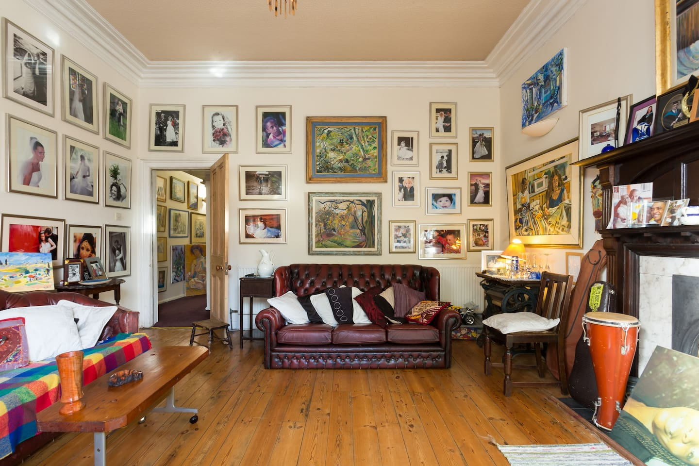 Front room full of paintings and wedding photos.