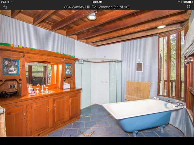 Beautiful bathroom with deep cast iron bath