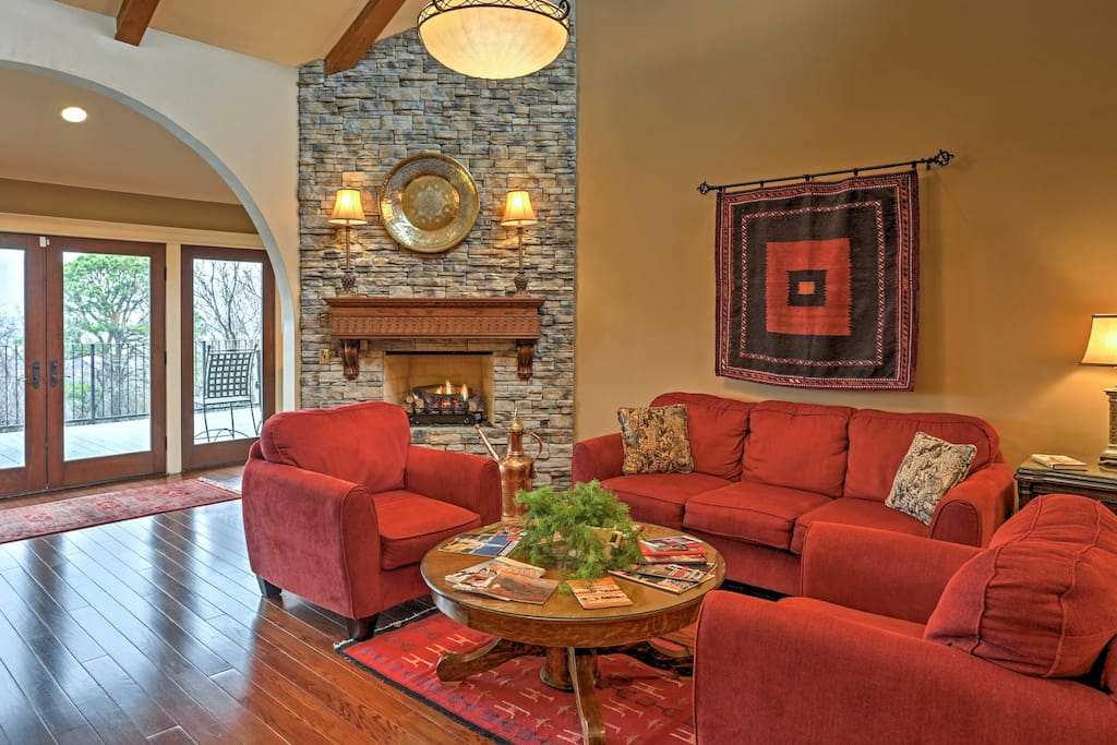 The open living area features a fireplace, TV, and a comfortable sitting area.