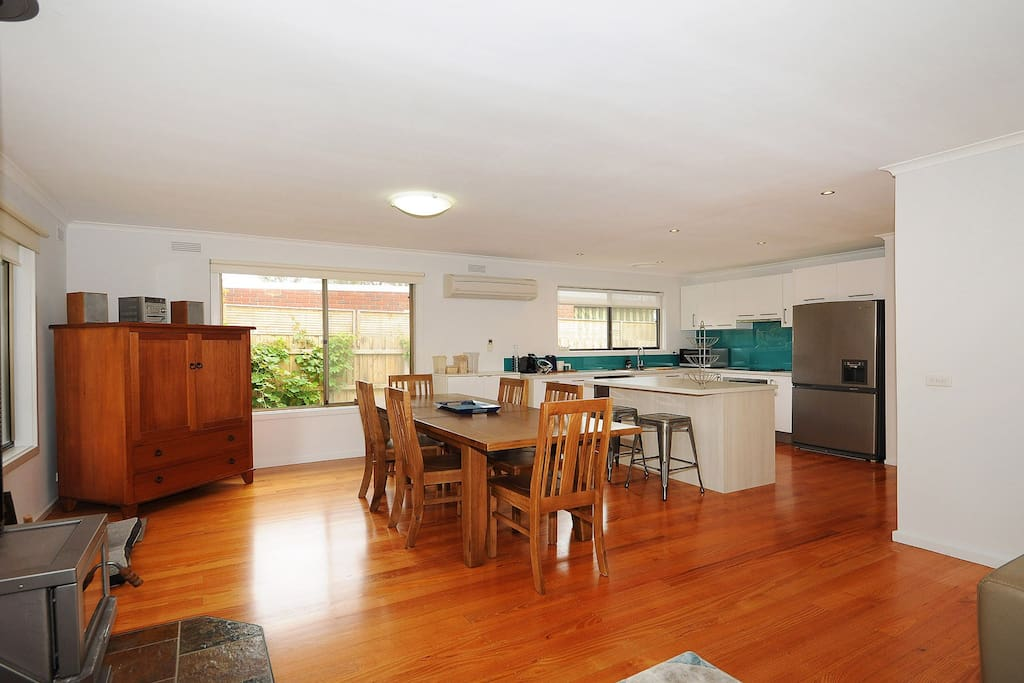 Open plan living and dining with a large air conditioner/heater