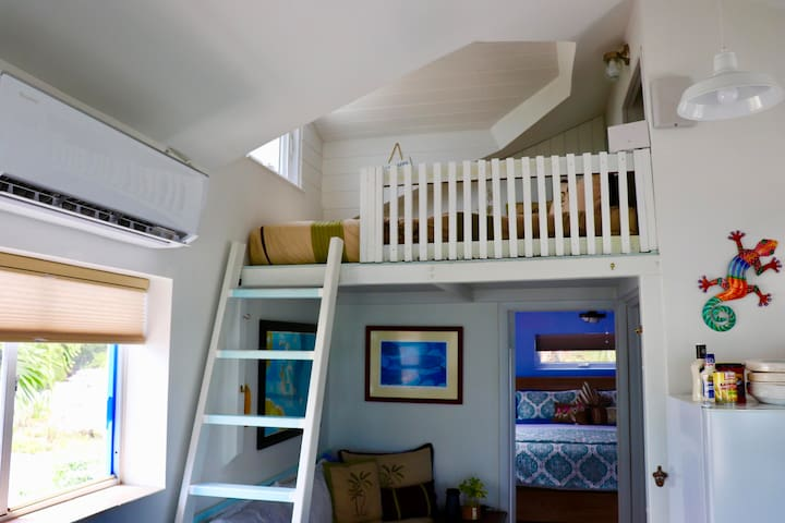 This is the loft queen size bed And a single bed below that is located in the main cottage in the open area