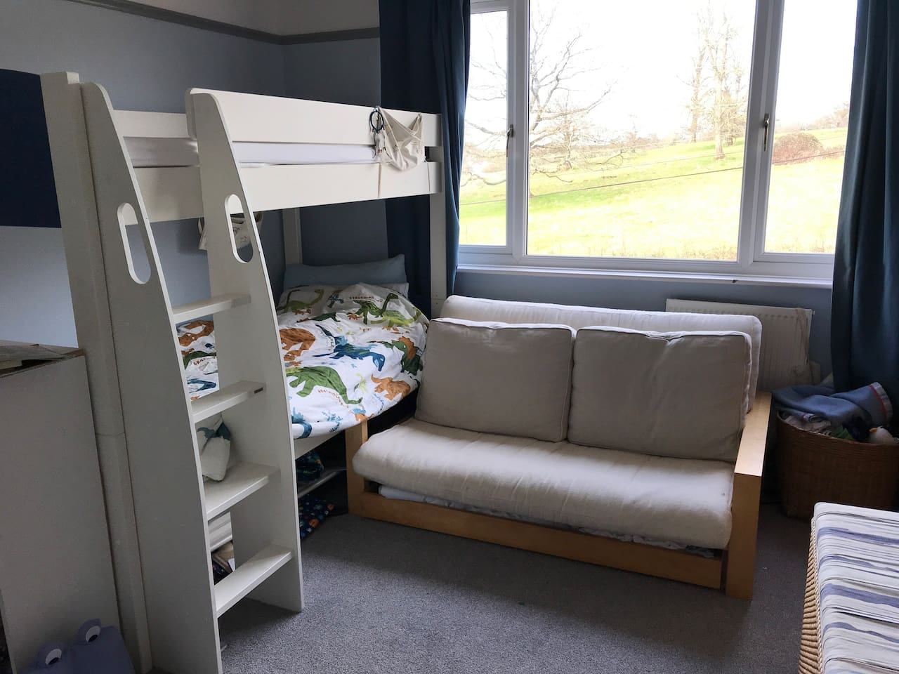 Second bedroom with bunk beds and small double futon.