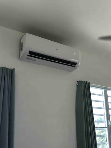 18,000 btu air conditioner keeps the room cool on hot days.  We do often get cool evening on shore breezes