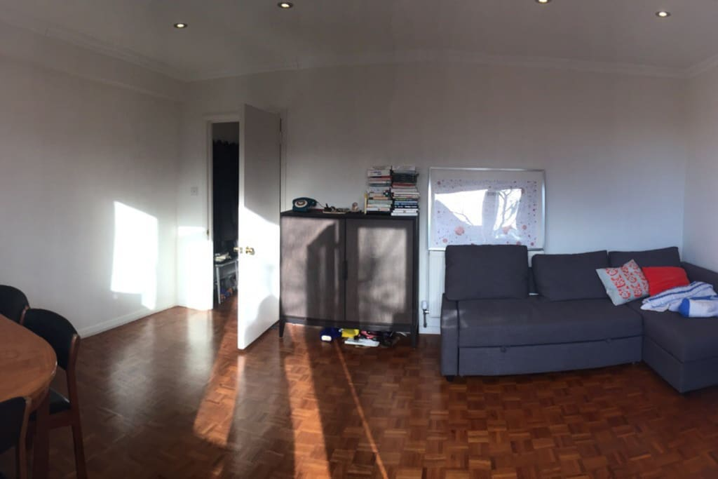 Large and Bright Living Room with a large sofa bed and dining table for 6.